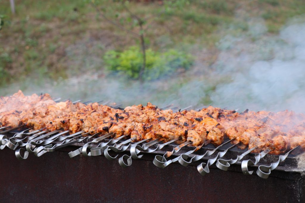 Shashleek in Ukraine - marinated pork cooking over a hot bed of coals